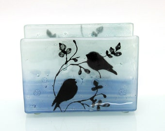 Fused Glass napkin holder ,black silhouette birds, blue landscape .
