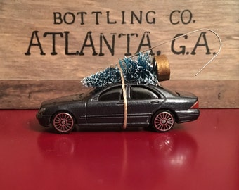 Mercedes Carrying Christmas Tree Ornament