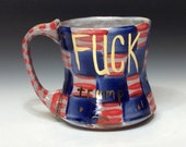 Fuck trump on the right side mug checkered design with gold luster and dots red striped handle