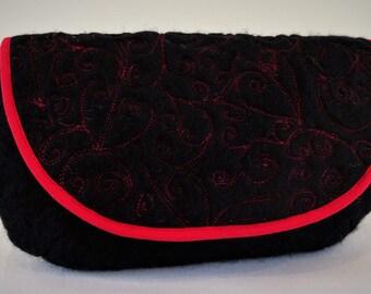 Small, hand felted, black clutch bag. Designer made.