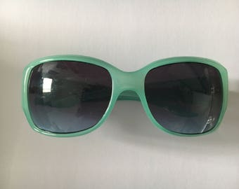1980s dead stock mint green sunglasses in great condition