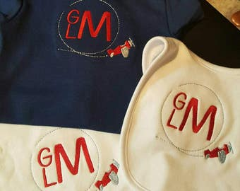 Baby gift: monogrammed onesie, bib and burp cloth