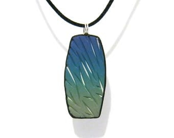 Skinny Teal to Green Carved Rectangle Pendant with White Underlay - Black Satin Cord Necklace - Polymer Clay - One of a Kind