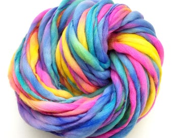 Super bulky handspun rainbow yarn, 60 yards and 3.35 ounces/ 96 grams, spun thick and thin in merino wool
