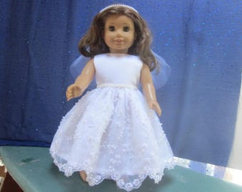 pearls galore on a communion dress will fit your 18 inch doll such as American Girl