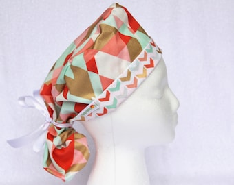 PonyTail Scrub Hat - Pony Tail Surgical Cap - Accent Fabric Fold up, Gold, Pink, and Turquoise Geometric