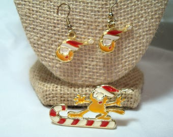 Vintage Garfield The Cat Skiing Sledding On Candy Cane Pin and Earrings Set.