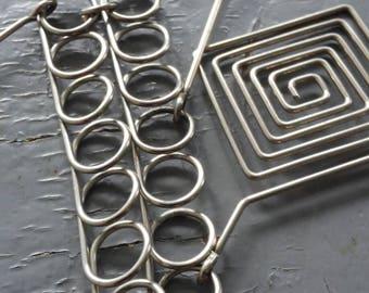 Spiral - unique geometric trio,  spiral metalwork & interlocking hinged statement necklace