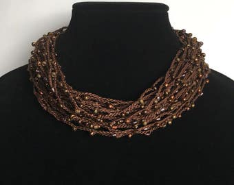 Crocheted multistrand necklace with beads