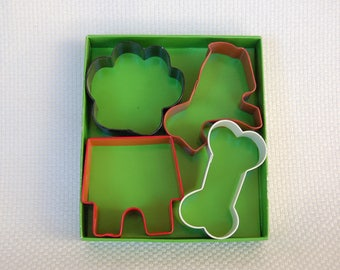Set of 4 Wilton Pet Shaped Dog Bone, Dog, Dog House, and Paw Pet Shaped Cookie Cutters Boxed Great for Homemade Pet or People Treats