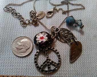 "Nice necklace ""claires"" multi charms,hangs 10 1/2"" when wearing"