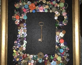 One of a kind vintage button frame featuring a vintage skelaton key