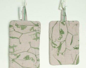 pale lavender and green hand dyed and printed linen hot pad with wild sweet pea
