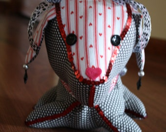 Decorated Stuffed Dog in Black, Red, and White Hearts Fabric with Red Sequin Trim