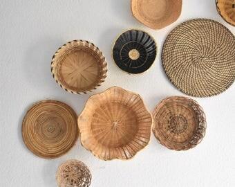 vintage set of 9 dark straw rattan wall baskets / black