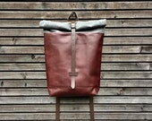 Leather backpack with waxed canvas  roll to close top and leather pannier conversion with dirt slap
