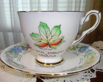 Beautiful Vintage Royal Stafford of China teacup and saucer and made in England est. 1845 floral and emblems of Canada Fine Bone China