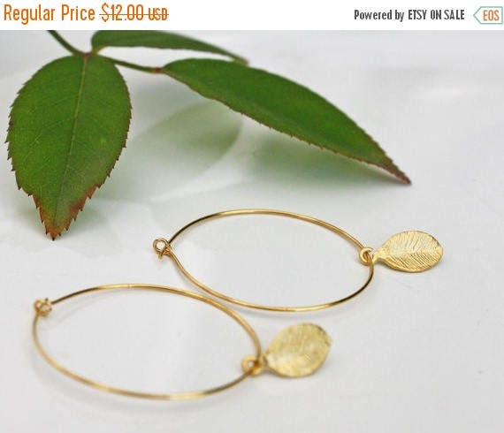 20% off. Delicate gold hoop earrings with tiny gold leaf