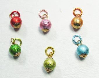 Nail Dangles 6 Different Colored Alloy Balls that are Shiny with a Design in them.