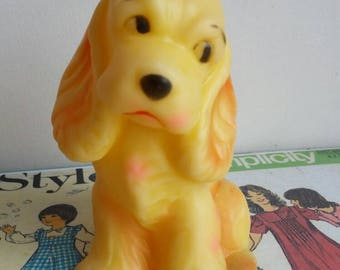 Vintage kitsch squeaky toy yellow spaniel dog