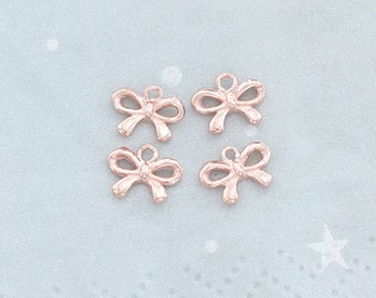 4 of 925 Sterling Silver Rose Gold Vermeil Style Small Bow Charms 6x8 mm.  :pg0309