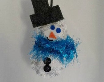 Snowman Ornament ... This is a cute handmade ornament... he is white with silver snowflakes and a sparkle blue scarf.