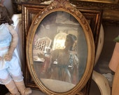 This Antique Gilt Gesso Oval Mirror Has The Brush Strokes