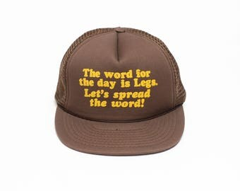 vintage 80s novelty trucker hat The Word for the Day is Legs Let's Spread the Word sexist slogan hat funny gag gift Cobra Caps snapback