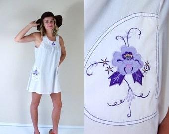 Sale vtg 70s WHITE purple embroidered MINI DRESS floral Medium tent babydoll pockets sun festival hippie boho dolly