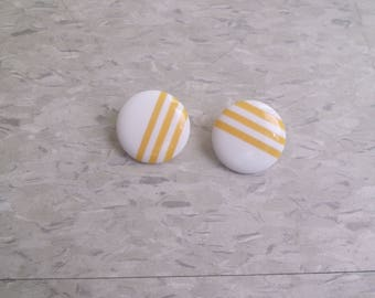 vintage clip on earringds white lucite circles yellow stripes