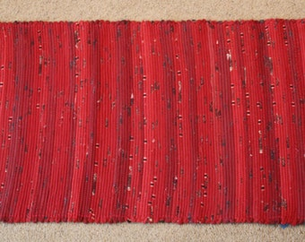 Handwoven Rag Rug: Red with Black Flecks, variegated  - 45 inches....(#135)