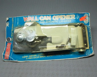 Vintage Swing-A-Way wall can opener unused in original package, white and chrome