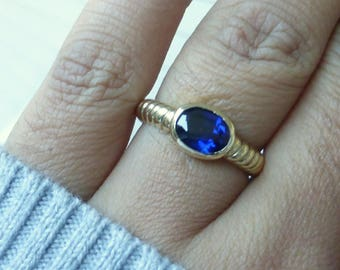 14k Custom made Blue Sapphire solitaire bezel ring. Sturdy!