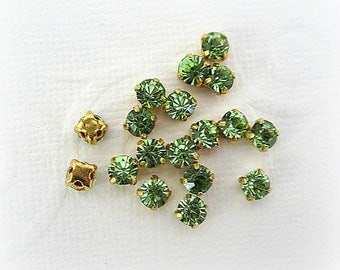 4mm Green Glass Sew on Rhinestones. Gold Colored Settings. 50 Pieces.