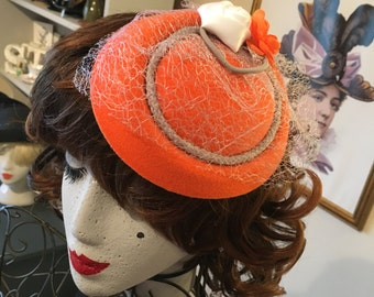 Mandarin orange white grey hat fascinator 50s style wedding party pin up photo shoot