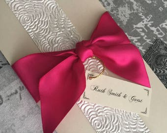 Vertical invitation, hot pink and cream with beautiful decorative border finish, ribbon wrap and name tag. Chic invite.