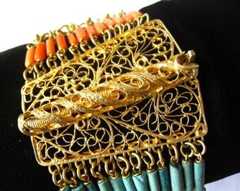 Egyptian Revival Bracelet c. 1930.  Brass Filigree Hinge Clasp. 12 Strands. Ornate Brass Links, Coral Beads & Turquoise Faience Tube Beads