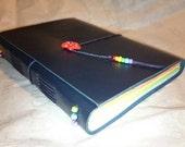 Reserved for herronjames rainbow interspersed journal dark blue cover