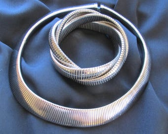 Silver tone metal serpentine flexible necklace and bracelet