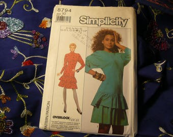 SIMPLICITY No. 8794, a Size 10.  A knit, tiered, ruffled dress with a dropped shoulder and long sleeves.  It is an Overlock/Serger Pattern