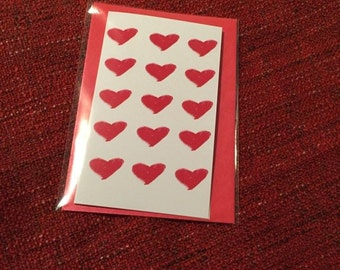 Red Filled Heart Pattern Card