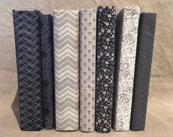 Set of 7 fabric covered books