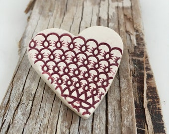 Handmade ceramic textured heart brooch in burgundy