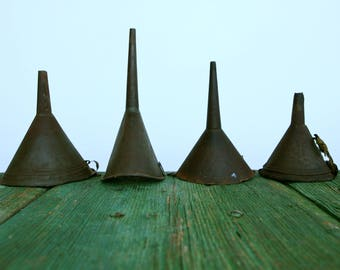 Collection of rustic Italian metal funnels