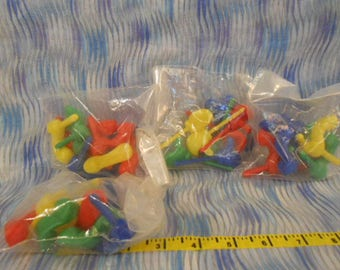 Four Sealed Bags Of Vintage/New Clown Shoes and Hands Cake Decorations