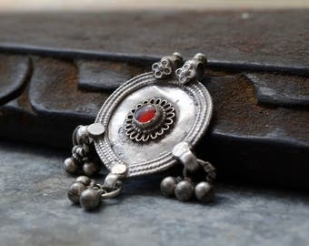 Indian silver pendant vintage tribal amulet with bells red gem round yoni drop shape tribal necklace focal feminine Rajasthan piece.