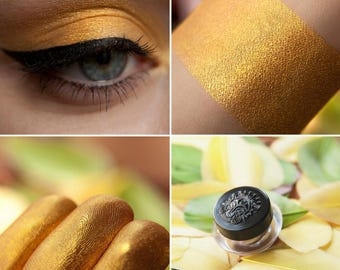 Eyeshadow: Golden Eyed- Nomad. Golden-orange metallic eyeshadow by SIGIL inspired.