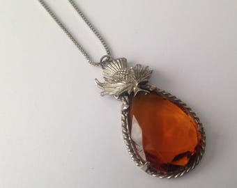 Vintage Silvertone and Large Amber Glass Stone Thistle Detail Pendant Necklace.