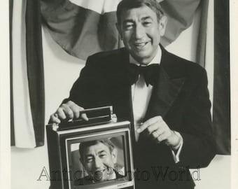 Sports journalist Howard Cosell with portable TV vintage photo