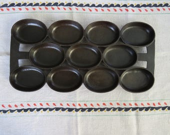 Antique or vintage cast iron oval gem pan similar to Waterman Number 8 cast iron gem muffin pan, circa 1800s